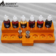 Promotional gifts christmas OEM wooden ecig stand holder for vape shop display for vaper mod atomzier drip tips e-liquids