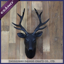 Carved deer head wall decoration