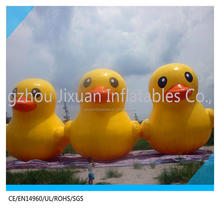 giant inflatable promotion duck floating on pool water