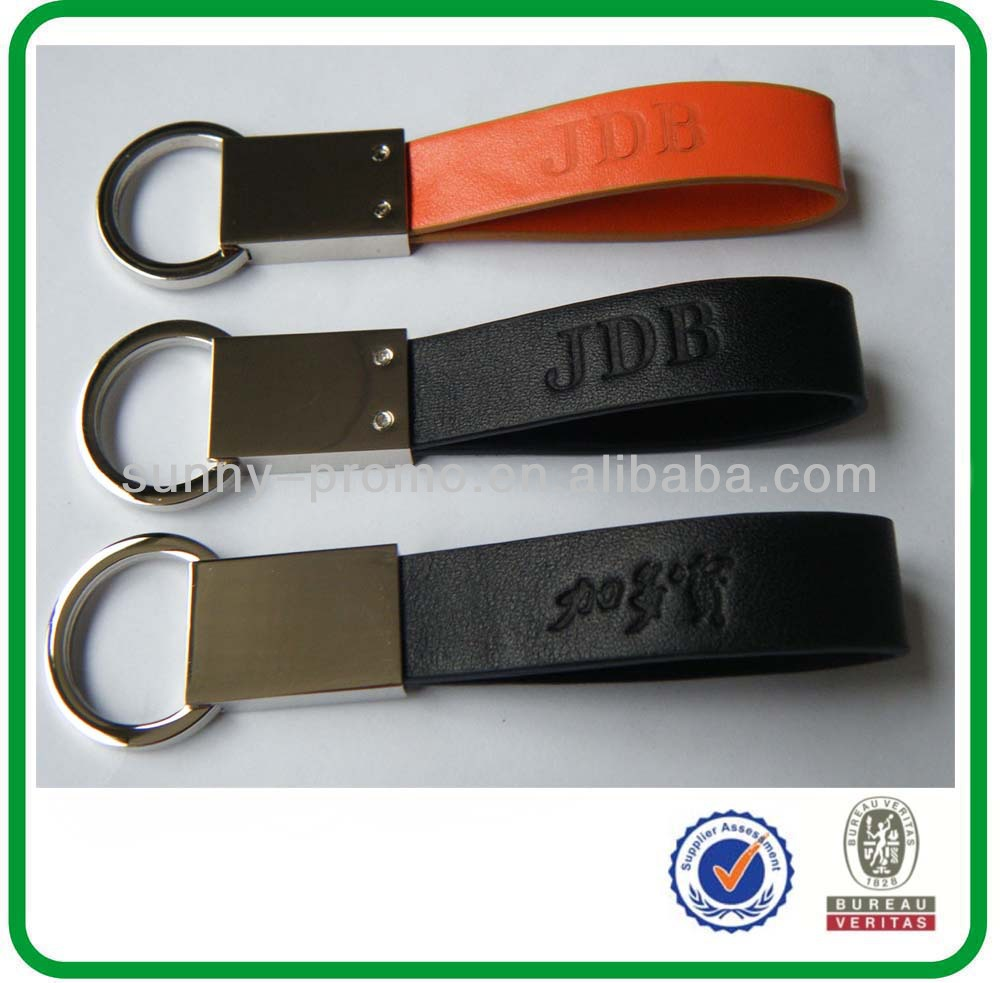 Custom made leather metal keychains with debossed logo