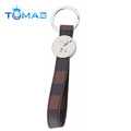 Strap shaped leather key holder with metal cup