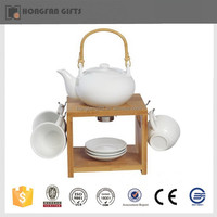 unique ceramic teapot warmer and cup saucer with wooden holder