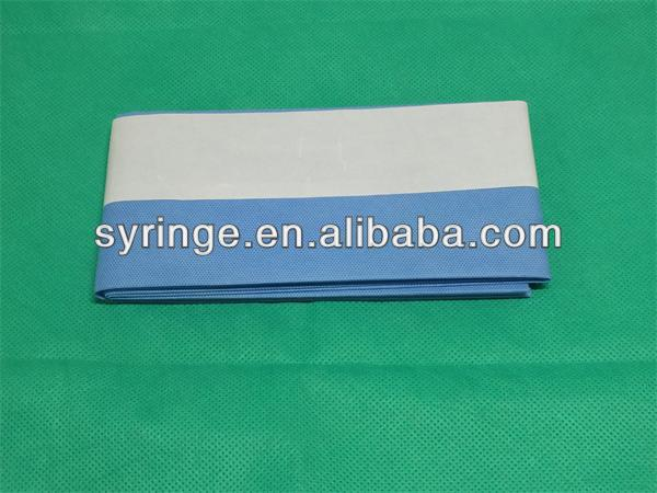 Non-woven utility drape with tape