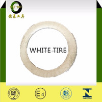 white coloured motorcycle tyre