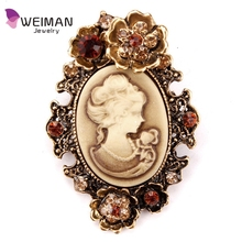 Crystal Rhinestone Flower Encrusted Cameo Brooches in antique silver and antique gold plated