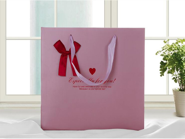 Factory directly custom high grade pink karft paper bags with bowknot printed shopping bags