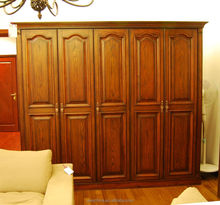 Antique oak wood bedroom wardrobe designs with casement doors