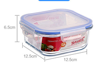 Square glass food container with silicone sleeve and vent