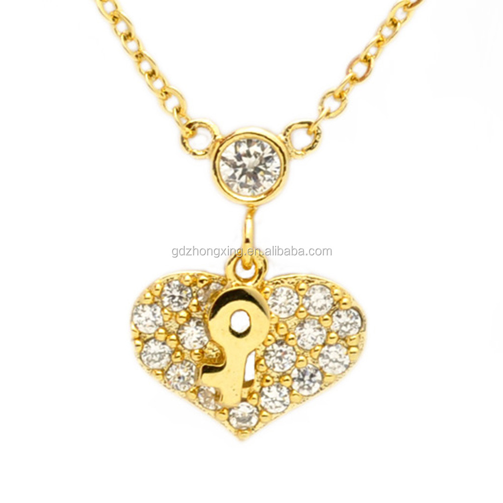 Ornamentation gold plated key charm with charm heart