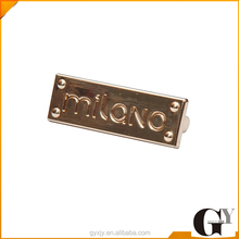 Rectangle gold metal badge for handbag