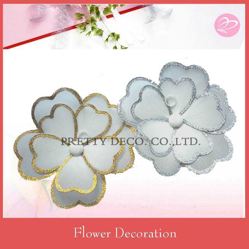 White lace flower with gold or silver glitter