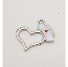 Factory wholesale zinc alloy silver plated enamel white and red color nurse charms