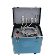 Luggage type portable dental unit with air compressor