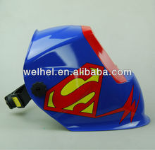 Hands free flip up welding helmet