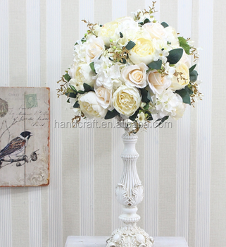 Centerpiece Flower Arrangement With White Rose Cascading Over The