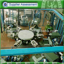 Rotary table cookware inside deburring machine