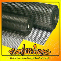 Fiberglass geogrids for road reinforcement with bitumen coated