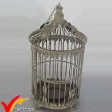 rusted round metal bird cage pet house