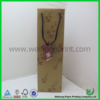 gold christmas paper wine gift bag