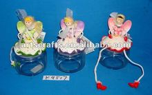 Polyresin fairy with glass candy canister
