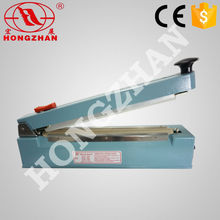 manual heat sealer bag sealing plastic hand impuse sealer machines with middle cutter
