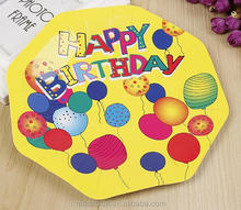 Yellow color octagon shape paper plate with many different color balloon for happy birthday