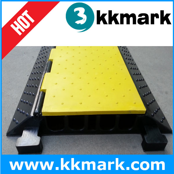 Outdoor adjustable cable protector, container load ramp