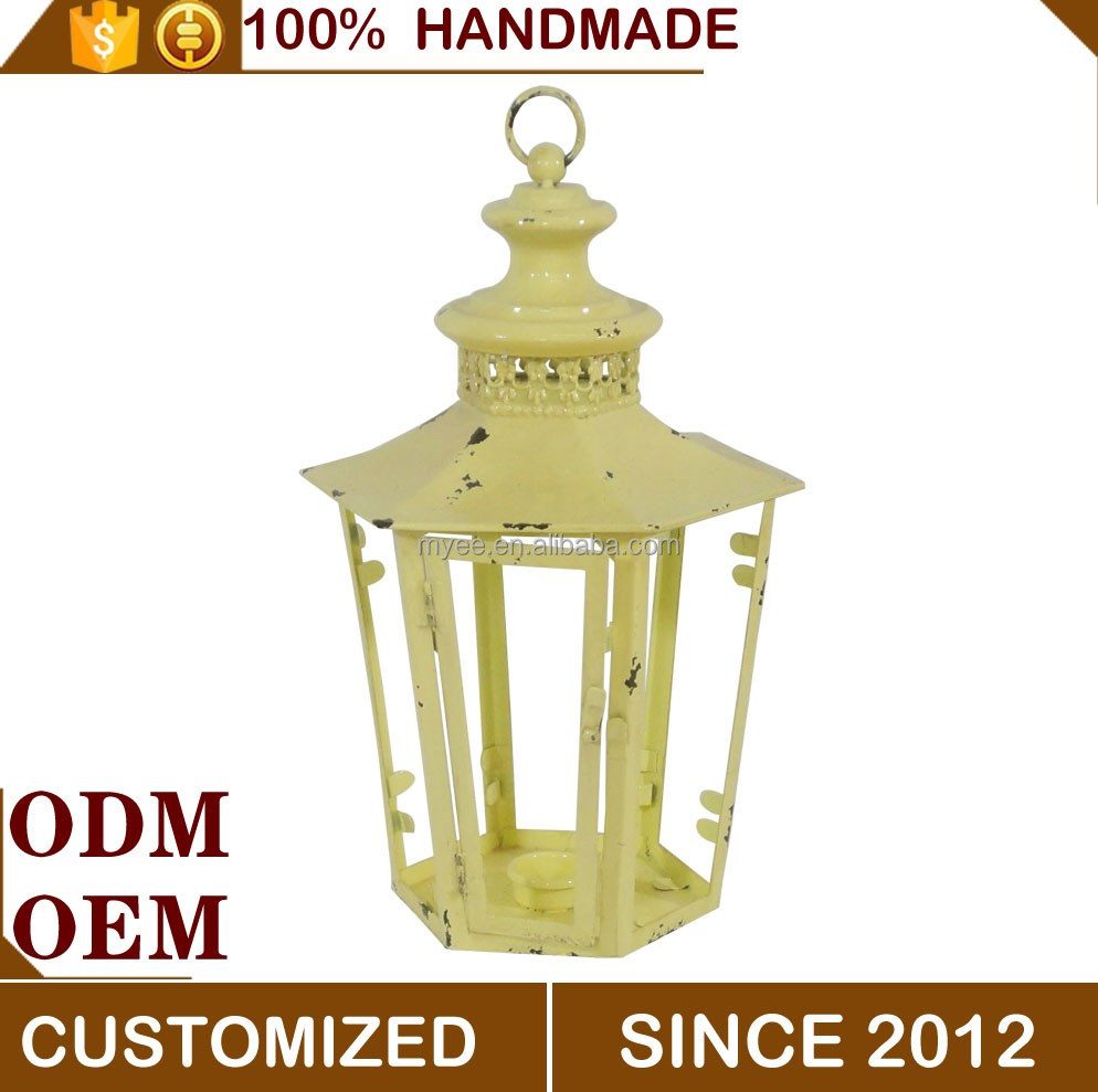 Decorative standing metal lantern for candle
