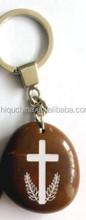 stone keyring with Christian religious words images engraved