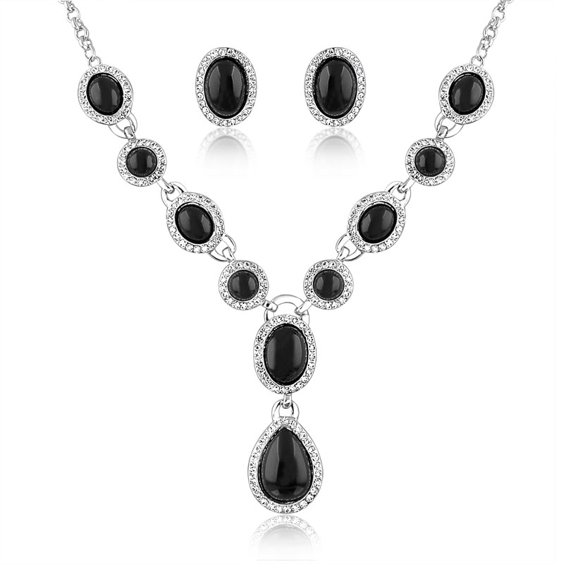 Abstract crystal set with ellipse ornaments around beside