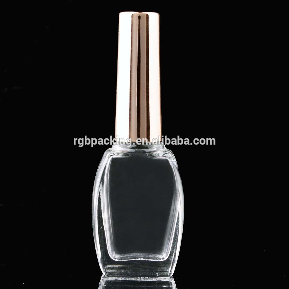 wholesale custom 15ml clear glass nail glue packaging bottle with gold metallic cap and brush