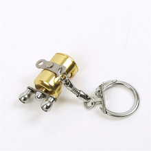 Fancy&Fantasy Fish Wheel keychain Gold Color Fly Fisherman Spinning Fishing Reel Charactor Miniature Key chain With Key Ring