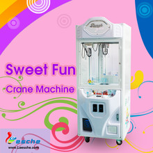 2017 Best selling coin operated claw crane machine / toy vending machine / doll grabbing machine from Guangzhou for sale