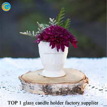 Colored glass candle holder with soy candle
