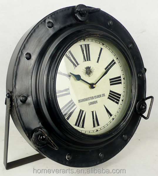 Antique black metal porthole style table clock