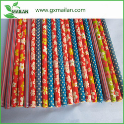 Dot and flower PVC coated wood broom handle
