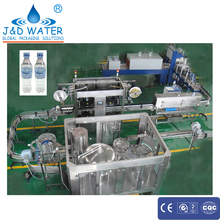 Complete drinking water bottling plant with double head labeling machine