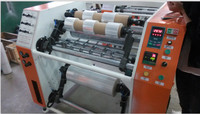 Automatic stretching film slitter and rewinder machine