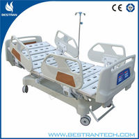 China BT-AE020 electric hospital medical patient care bed, ICU room bed with central wheels, IV stand