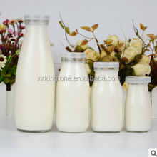 Empty transparent glass milk water bottle with lids