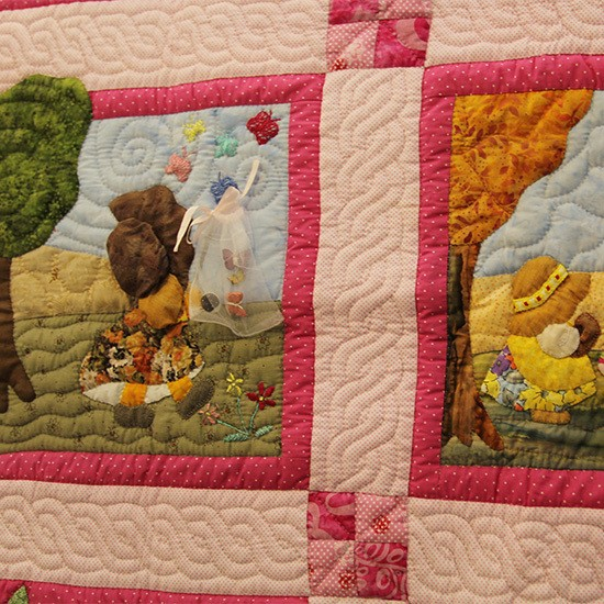 Cotton Bed cover with a variety of motifs and quilting thread