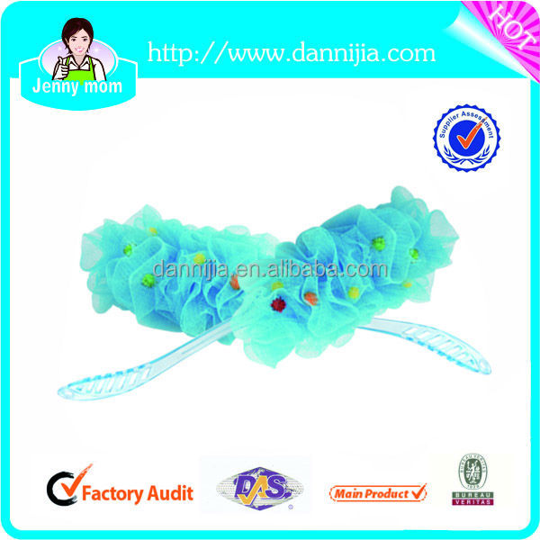 The bath loofah with long plastic handle