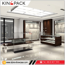 Glossy high quality custom made wall mount display shelves standing rack glass vitrine display showcase for boutique store