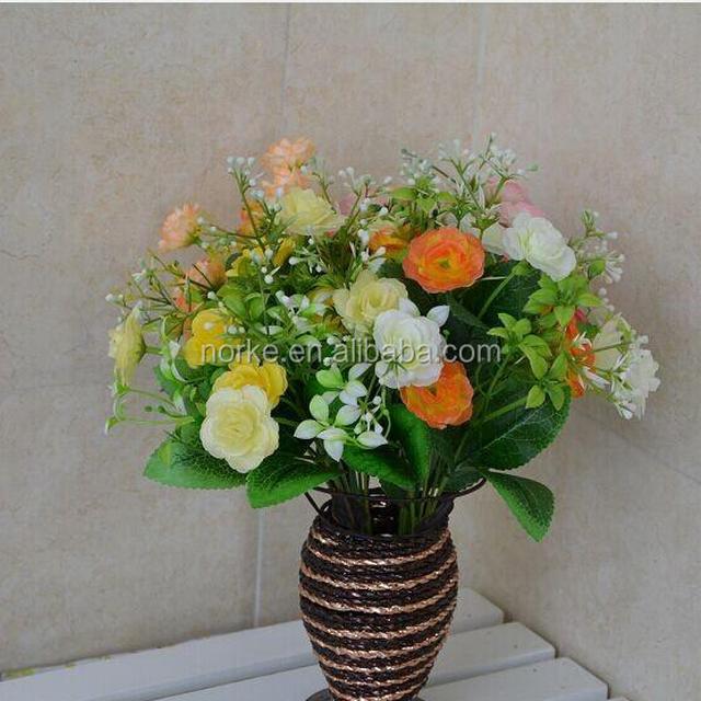 artificial flowers arrangements in vase