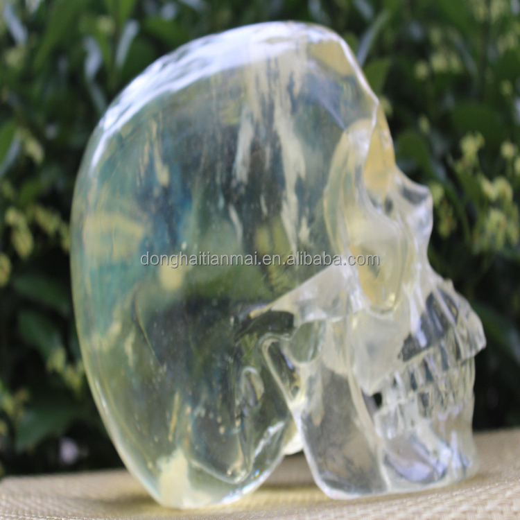 Charming handmade life size clear crystal skull with live chin for sale