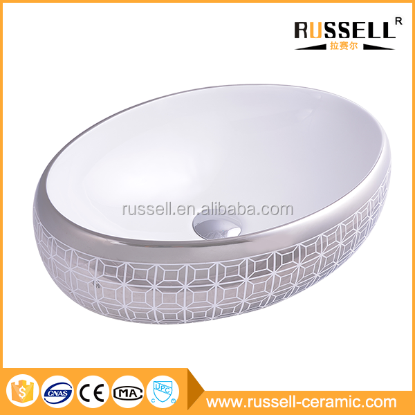 Fahion color sanitary ware counter top ceramic oval silver wash basin