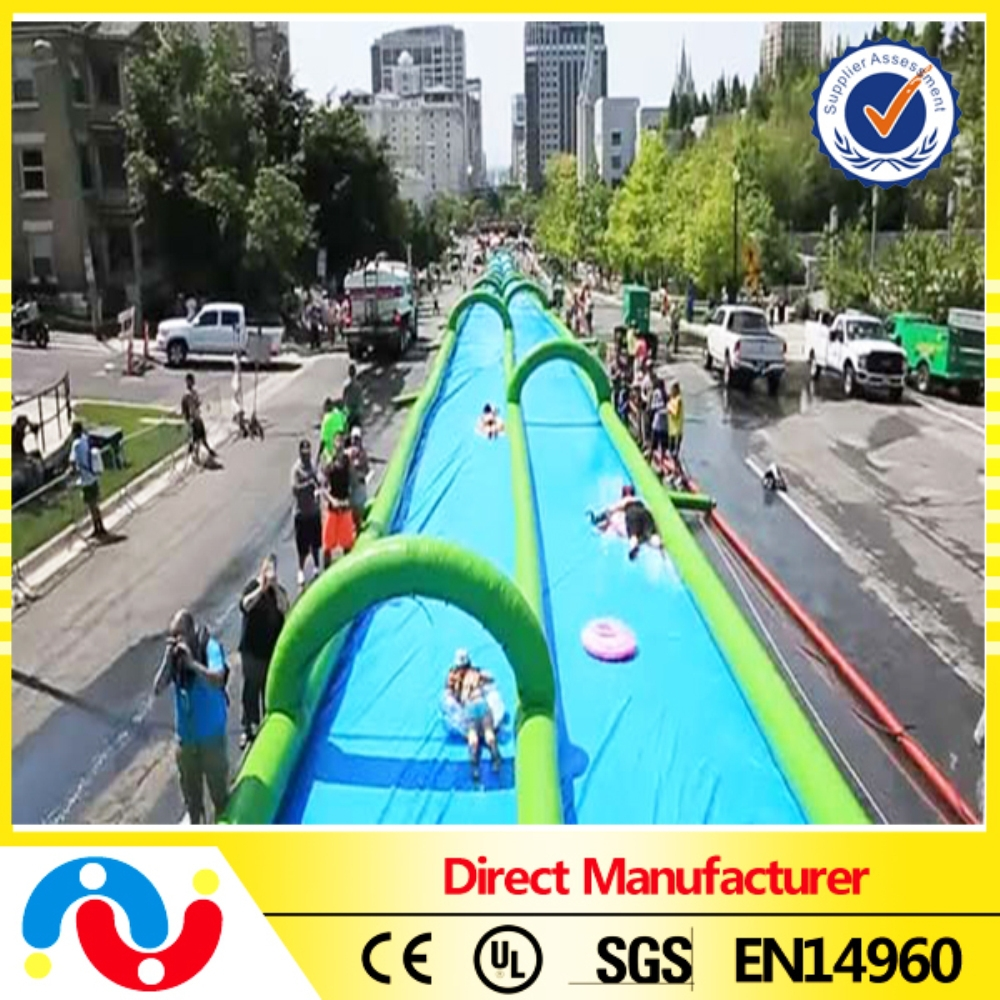PVC tarpaulin inflatable water slide,custom inflatable slip n slide the city