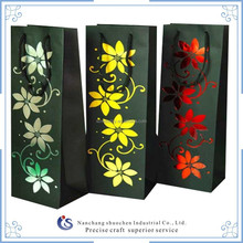 black art paper carrier bag with printing flowers