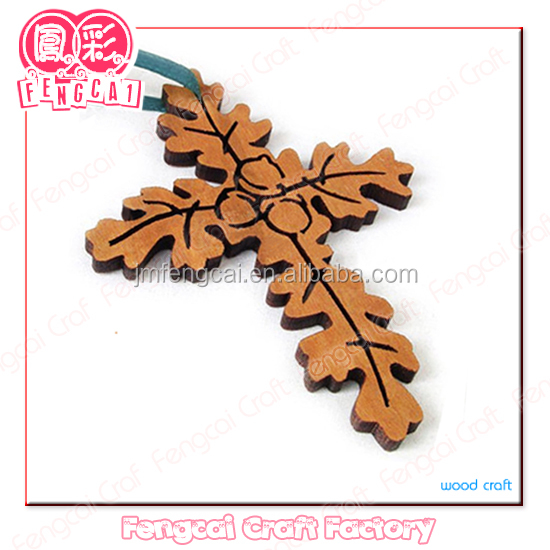 religious wood crucifix with leaf pattern