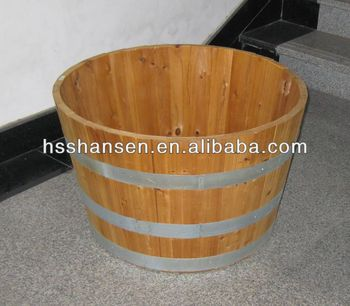 round wooden flower planter with hoop iron
